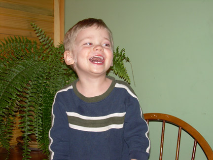 Source photo of boy laughing.